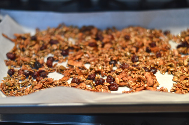 seed granola cooking in oven on parchment paper